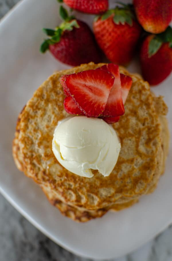 Oatmeal pancake short stack with fresh strawberries