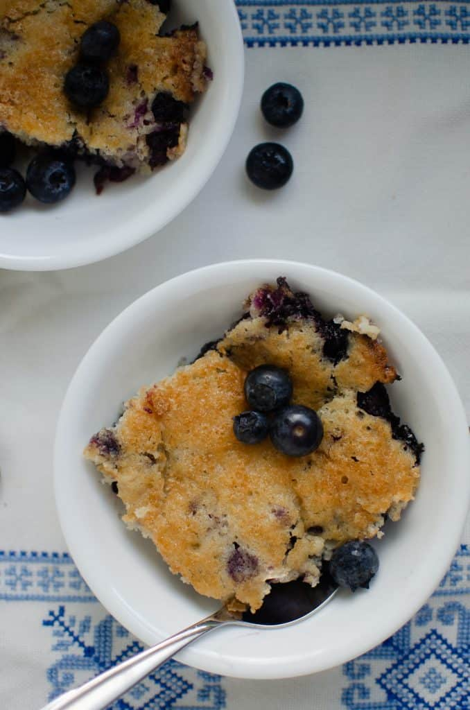 piece of blueberry cobbler in white dish