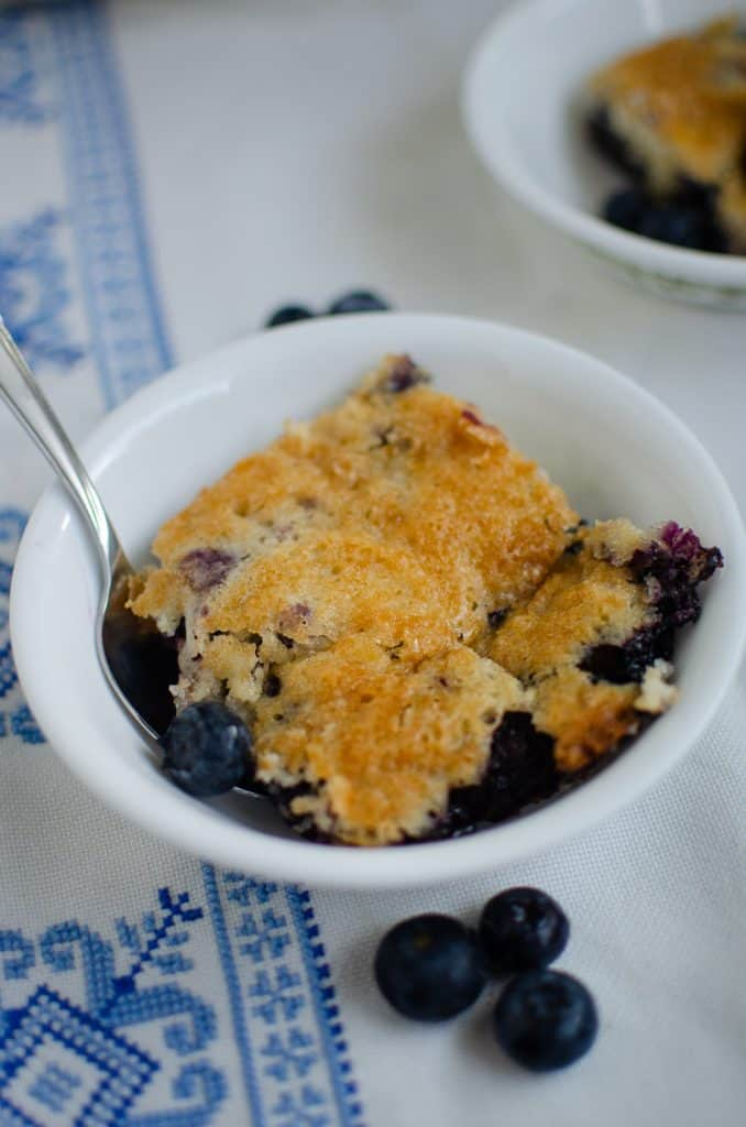 blueberry cobbler in small white bowl