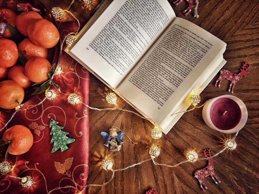 Christmas book flatlay with lights and books