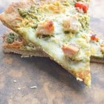 Chicken Pesto Pizza with garlic and roasted red peppers. Delish!