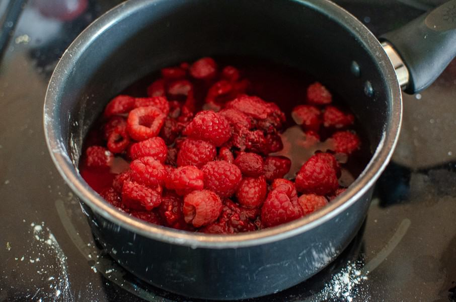 raspberries in saucepan cooking
