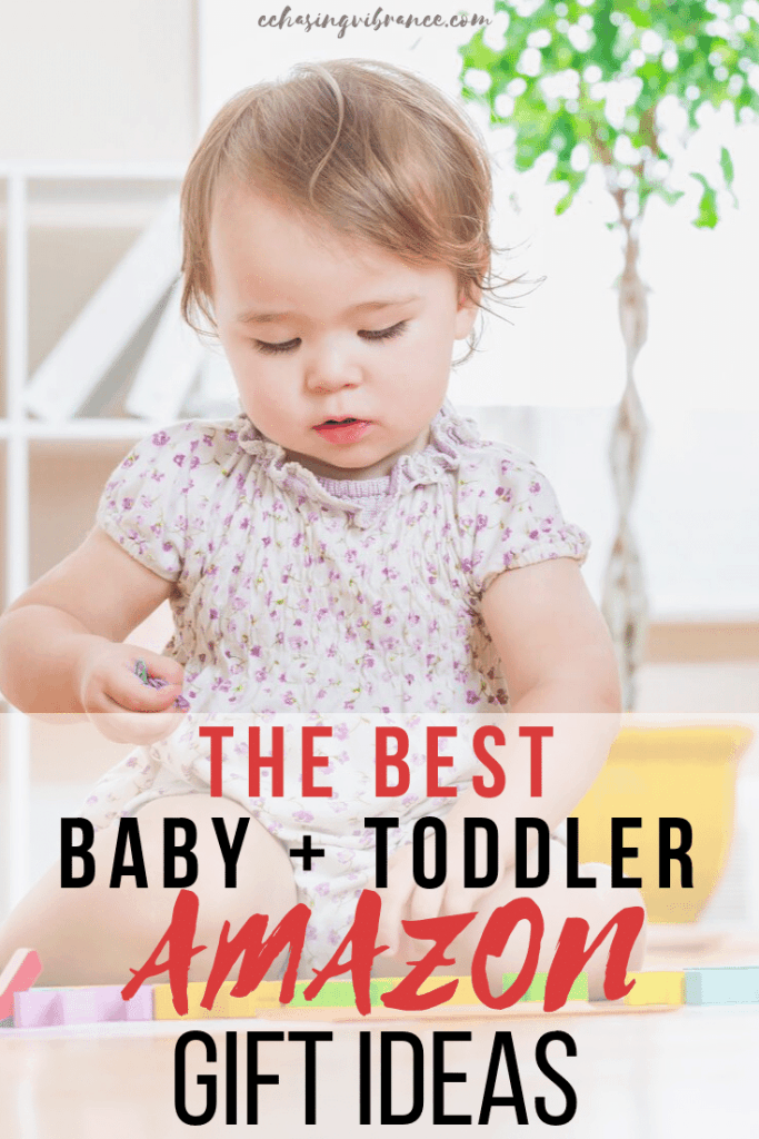 "baby playing with toys and overlay text ""the best baby + toddler gift ideas on Amazon"""