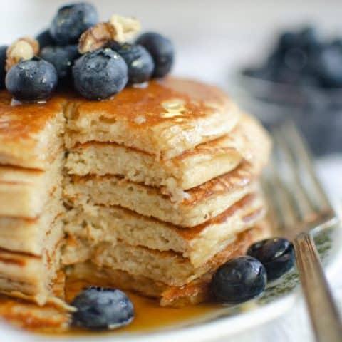 photo of stack of yogurt pancakes with bite taken out