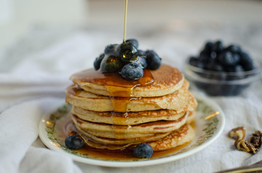maple syrup running down pancake stack
