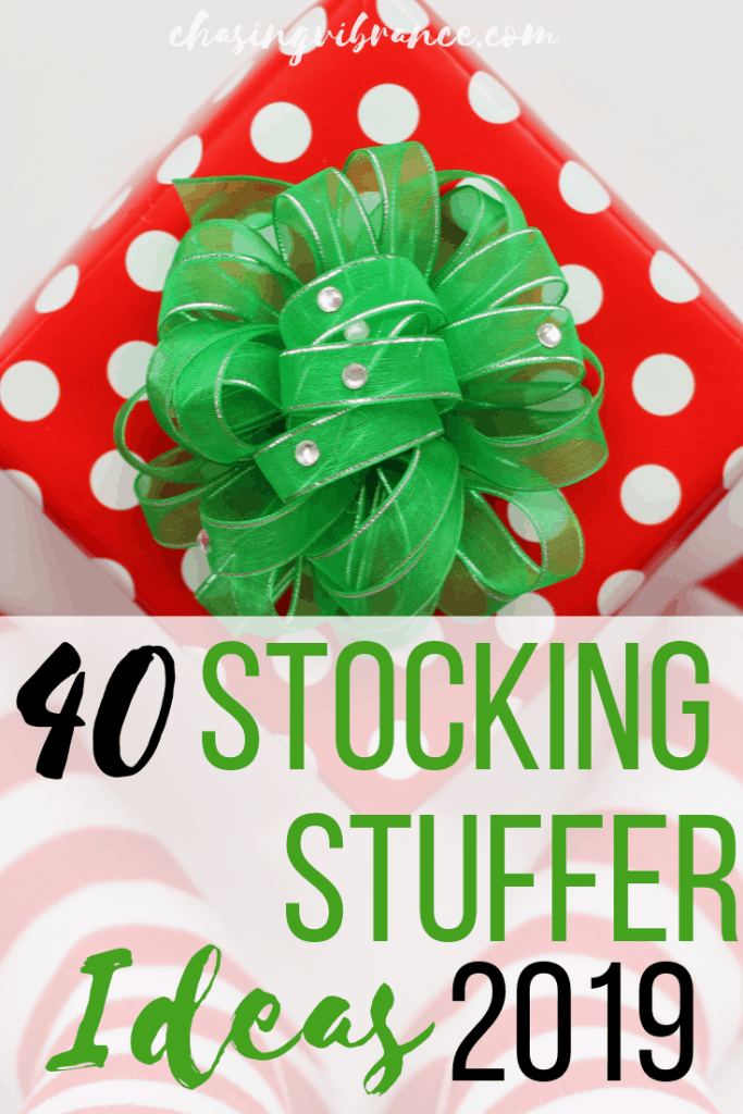 Small gift with polka dot wrapping and green bow with text 40 stocking stuffer ideas 2019