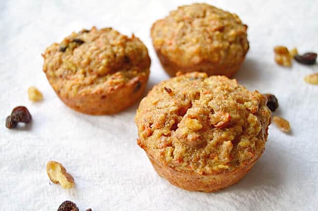 three healthy morning glory muffins on white background