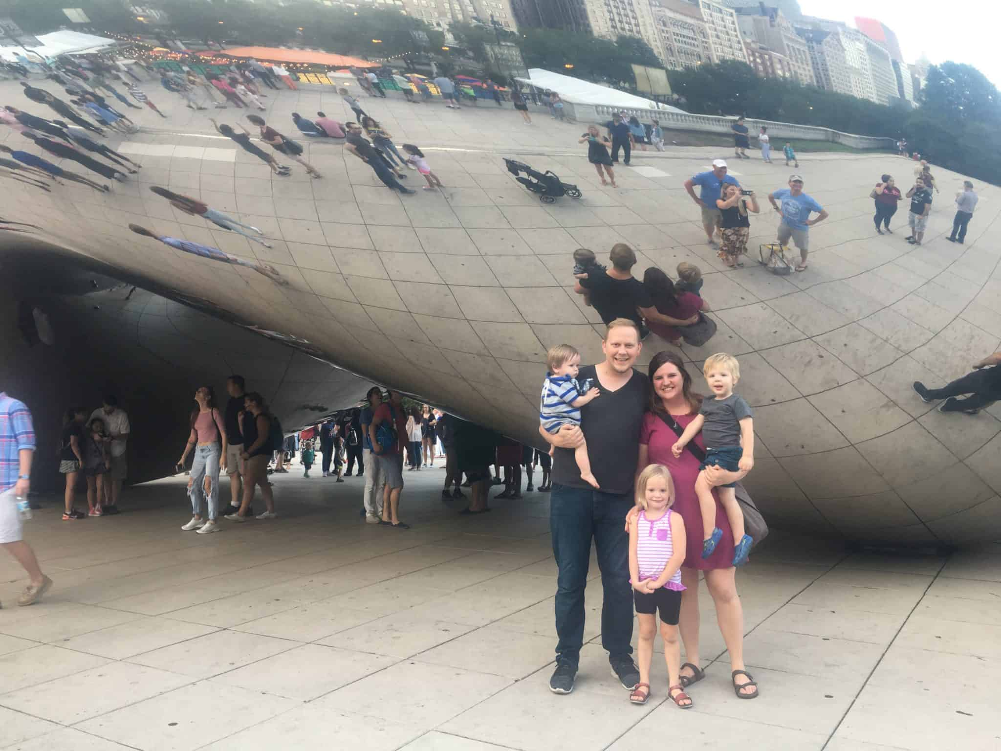 Family in Chicago in front of the bean statue
