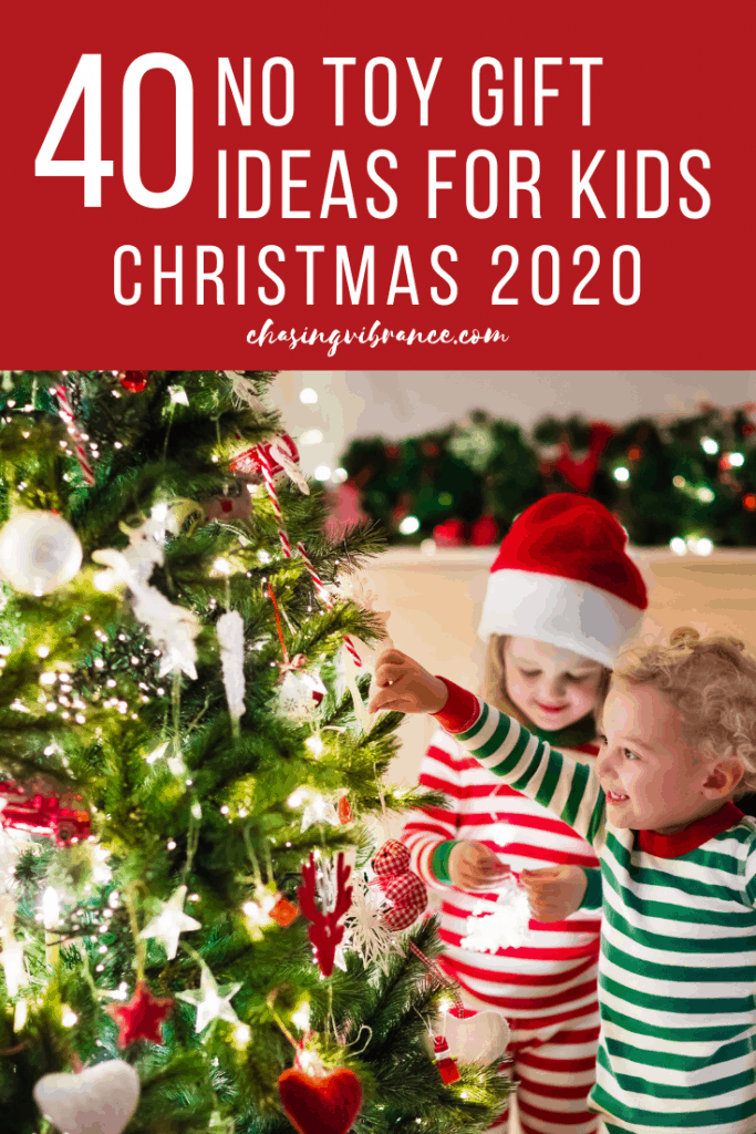 text 40 no toy christmas gift ideas for kids christmas 2020 with two children in jammies decorating christmas tree
