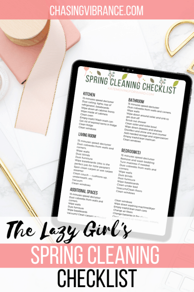 ipad with spring cleaning checklist on pink flatlay with text overlay