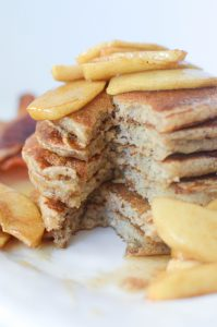 Apple cinnamon pancakes topped with maple cinnamon apple slices