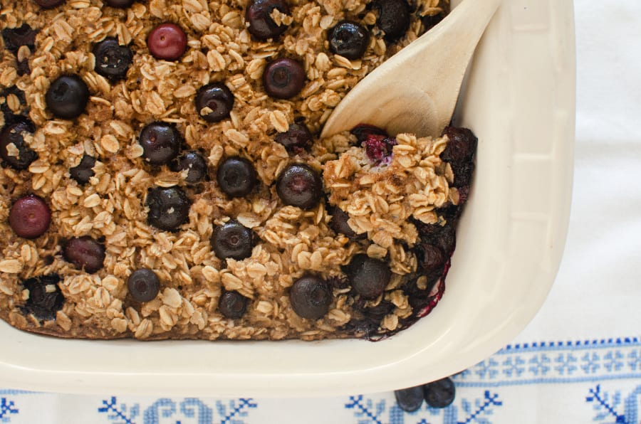 Blueberry Baked Oatmeal -in pan with wooden spoon
