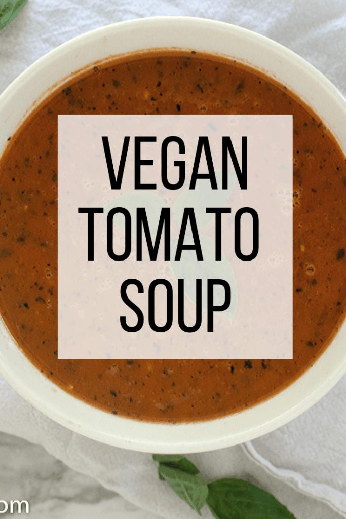 Vegan tomato soup text overlay over bowl of tomato basil soup