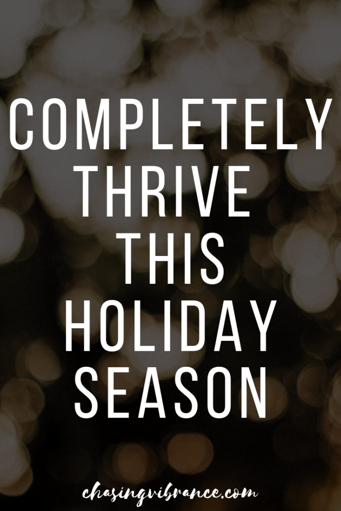 """""""completely thrive this holiday season"""" text overlay on holiday lights"""