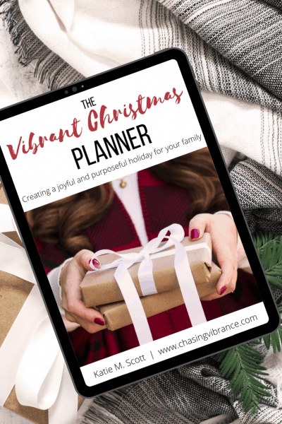 Christmas planner laying on cozy blankets and greenery