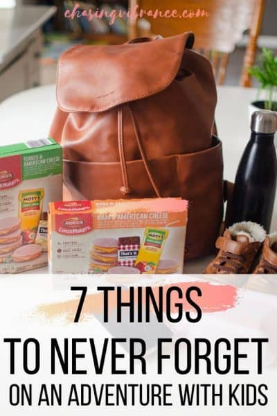 7 things to never forget on an adventure with kids text overlay of leather packback and kids snacks and supplies