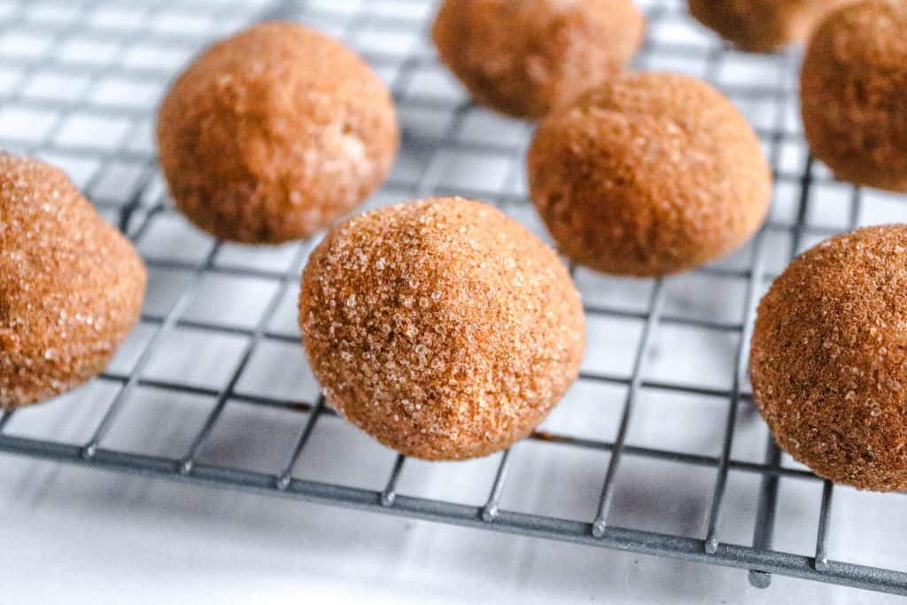 Rolled pumpkin pie balls on cooling rack