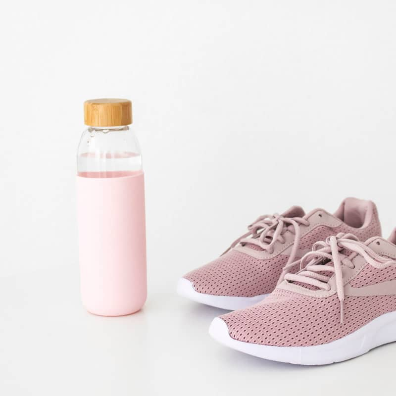 pink water bottle and pink athletic shoes