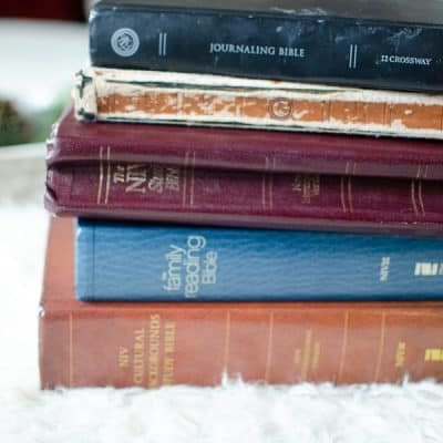 stack of colorful bibles on a fuzzy blanket