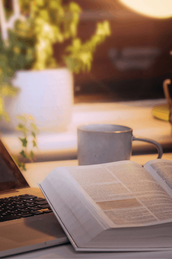 Bible and cup of coffee with light streaming from back corner