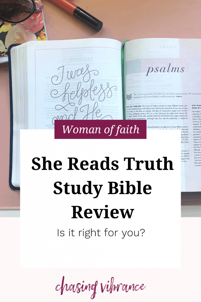 Photo of the She Reads Truth Study Bible open on a pink background with pens, journal and lipstick surrounding it